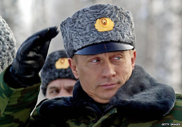 Putin in uniform and hat